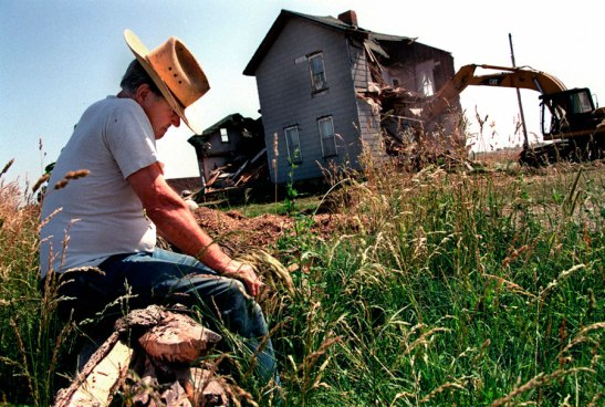 Harlow Cagwin watches his house being torn down to make way for a subdivision. Image 2014 © Scott Strazzante, from Common Ground, PSG Books