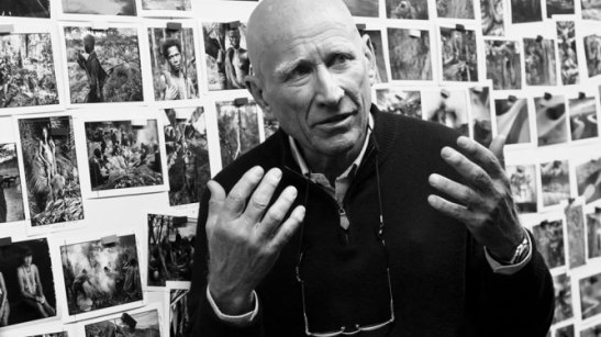 Sebastiao Salgado surrounded by his images in The Salt of the Earth.