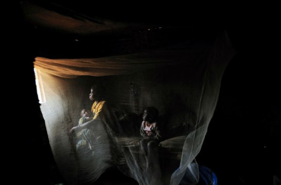 Kahindo, 20, sits in her tent with her two children born out of rape in North Kivu, Eastern Congo, 2008. Lynsey Addario/Getty Images Reportage