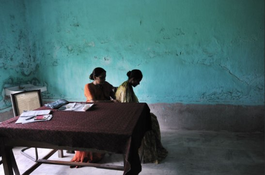 A doctor checks a patient for signs of tuberculosis in India, 2010. Lynsey Addario/Getty Images Reportage