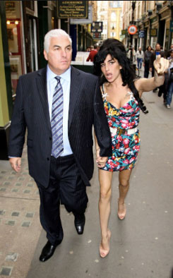 Winehouse with her father Mitch in London.