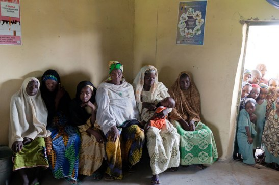 Women and girls wait at a clinic in rural Nigeria. Image (c) Mark Tuschman
