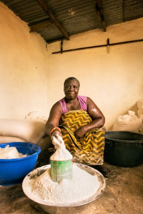 Microfinance loans have helped women like Ghanaian Evelyn Quartey, who is now a distributor of flour. Image (c) Mark Tuschman