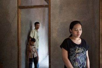 A victim of human trafficking, Seni was eventually reunited with her husband and son. Image (c) Mark Tuschman