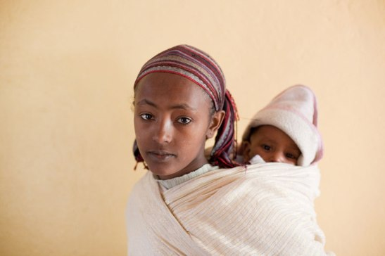 In Shire, Ethiopia, this young woman is with her second child. Image (c) Mark Tuschman