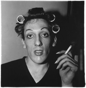 A young man in curlers at home on West 20th Street, N.Y.C, 1966, (c) Diane Arbus