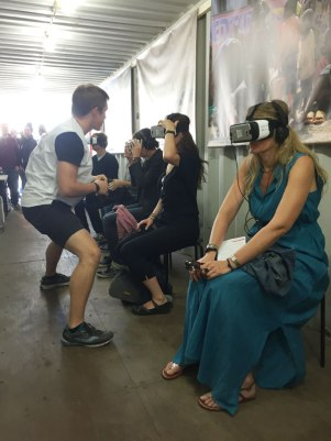 Viewers watch virtual reality documentaries in the Doctors Without Borders container. Photo (c) Sarah Coleman